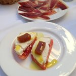 Complimentary tomato with cheese starter and half serve  jamon