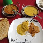 Mushroom curry, yellow dhal, parathas, and rice