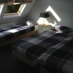 Bedroom with three very comfortable beds and two great roof windows
