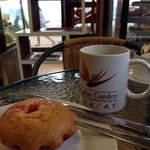 Strawberry muffin and brewed coffee on a windy and rainy July afternoon.