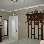 Green Room (#3) No closet, no problem!  Room 3 features a beautiful custom made wall rack.