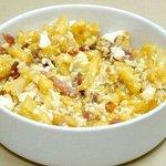 Huevos revueltos con papas,jamon y piñones