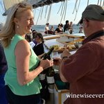 Erica meeting guests and answering wine questions on our Sunset Wine Sail in Casco Bay