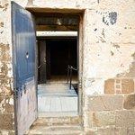 Enter through the door to the execution yard