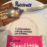 In the dishwasher ..... Love the humour of this place it's even on their saucers!