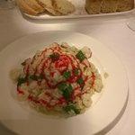 risotto con gamberi bianchi, taccole e coulis di lamponi