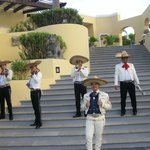 Mariachis playing near the pool