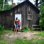 Daughter and granddaughter if front of the cabin..