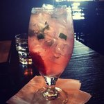 featured drink - muddled strawberries, basil, vodka, lemonade and sprite.