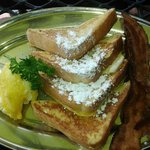 French Toast with 2 eggs and bacon ($10)