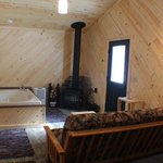 Romantic Cabin siting area with whirlpool tub & woodburner