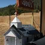 Mailbox for the winery across the road from your turnoff.