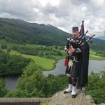 Stephen Dewar of Scotia Pipers playing his bagpipes at Queen's View