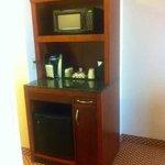 Microwave, coffee and fridge.
