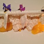 crispy coconut meringues over roasted pineapple