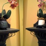 Left mirror sconce: fine. Right: Broken and styrofoam just sitting there