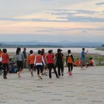 exercise class on banks of Mekong River