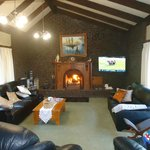 Large lounge with open fire, satelite TV, seating for seven.
