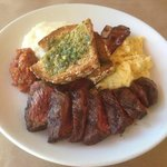 Hanger Steak, Bacon Rashers, Grits, Scrambled Eggs and Whole Grain Toast