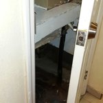 Air handler room open IN the bathroom with thick dust, garbage and dead roaches inside