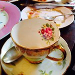 An eclectic collection of pretty tea cups and plates