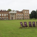 House and lawns with deck chairs to use