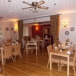 Spacious dining room with extensive breakfast menu