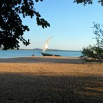 Pumulani beach with dhow waiting