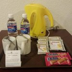complimentary drinking water, 3 in 1 cereal, coffee & milk tea and 2 packets of biscuit - love t