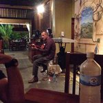 Live music from a very talented man!! He plays Spanish guitar and plays the keyboard and sings!