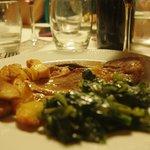 Stinco di maiale con verdure e patate; pork shin with vegetables and potatoes