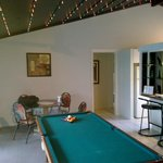 dining area and pool table that sits between the lounge and dining