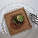 raw salmon around bison tartar with spicy sauce