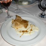 poached pear with puff pastry, caramel and cheesy sauce