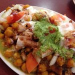 The Samosa Chaat (crispy potato and spice pastry covered in chick peas, sauce, spice, and vegeta