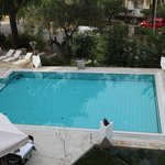 View of swimming pool from room balcony