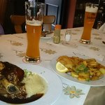 Roasted hock, snitzel and unfiltered beer (heffe weiss bier)