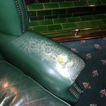 A well worn chair in the library