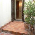 Patio door into room from courtyard