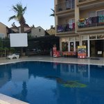 hotel and pool showing large tv screen
