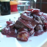 Beef fillet with bacon and grapes
