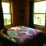 Very comfortable bedroom, peaceful view of the grounds and woods.