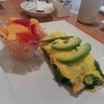 Korner Omelette- Three eggs w/ Spinach, cream cheese, bacon, tomato and avocado slices. YUM