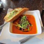 Tomato Bisque with sugar snap pea