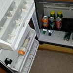 Half-empty mini bar, with previous occupants' leftovers!