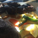 Tips, Baked Potato, and Steamed veggies