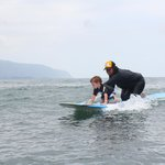 My 4yr old son with surf instructor