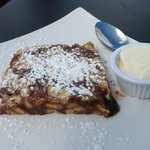 Wonderful cake served warm with chocolate drizzled inside, and powdered sugar sprinkled on top w