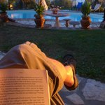 Reading by the pool early evening