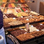 Market selling sweets, nuts, juice, fruit etc